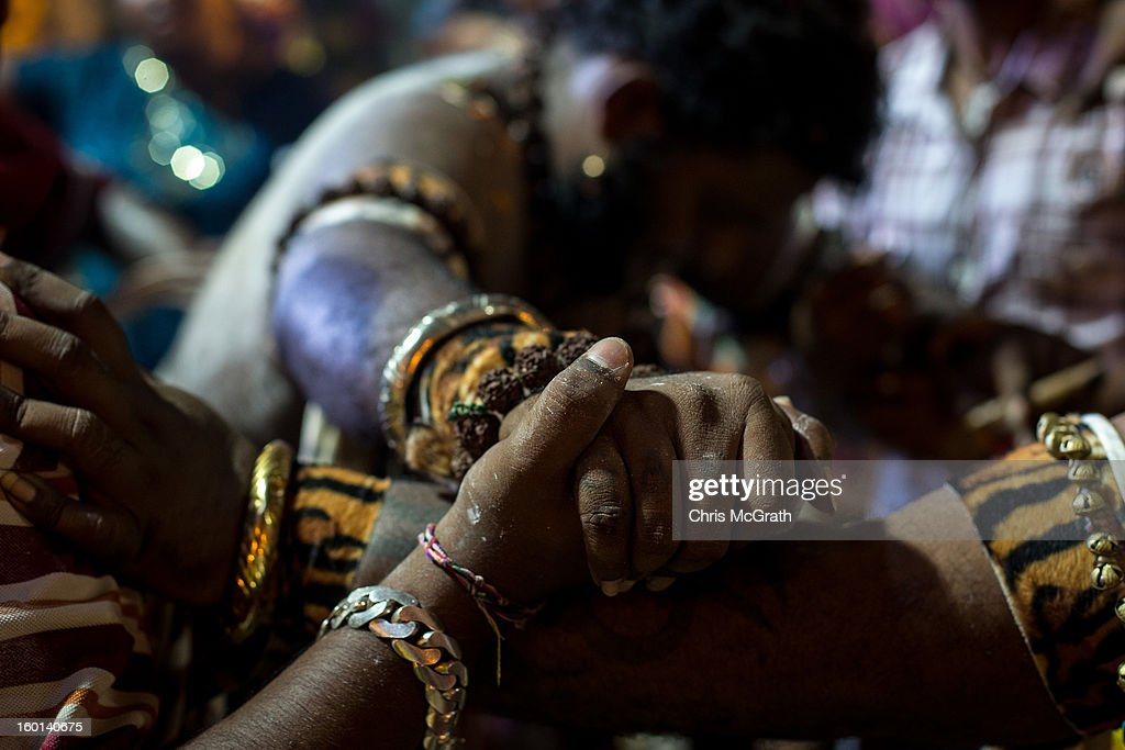 A devotee is held up by friends after collapsing during his Thaipusam procession on January 27, 2013 in Batu Caves, Malaysia. Thaipusam is a Hindu festival celebrated on the full moon in the Tamil month of Thai. The festival marks the birthday of Lord Muruga and also commemorates the day Hindu Goddess Parvati gave her son a lance to defeat the evil demon Soorapadamwhen. The festival sees devotees carry milk pots to seek forgivness and some will carry a 'Kavadi' many of which are attached via, strings, hooks, and skews pierced into the carriers skin.