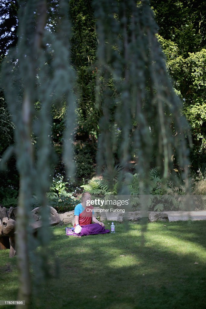 A devotee meditates in the George Harrison Memorial Garden during the Janmashtami Hindu Festival at Bhaktivedanta Manor on August 28, 2013 in Watford, England. Up to 72,000 were expected to take part in the Hindu festival of 'Janmashtami', which falls on August 28 this year, and marks the birth of the Hindu god Lord Krishna. The festival is believed to be the largest Hindu festival gathering outside of India. Bhaktivedanta Manor is also celebrating it's 40th year since the manor house was donated to the Society of Krishna Consciousness by George Harrison in 1973.