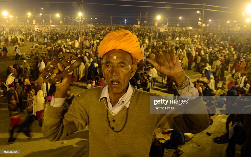A devotee offer prayer at Sangam, the confluence of River Ganga Yamuna and mythological Saraswati on the occasion of Maghi Purnima the main holy bathing day during Magh mela festival.