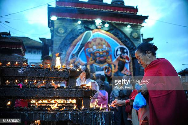 SQUARE KATHMANDU NEPAL KATHMANDU NP NEPAL Devotee offering butter lamps infornt of Kaal Bhairab on the occasion of Navami ninth day of Dashain...