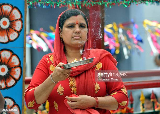 A devotee offering prayers on the first day of Navratras at Babe Wali Mata temple on October 13 2015 in Jammu India The ninedaylong Hindu Navratri...