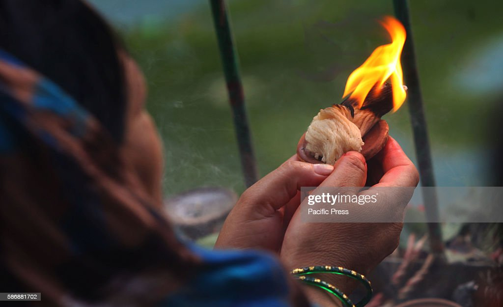 NAGPOKHARI KATHMANDU NEPAL A devotee offers prayers during Nag Panchami festival at at Nag Pokhari in Kathmandu Nepal Nag Panchami is a traditional...