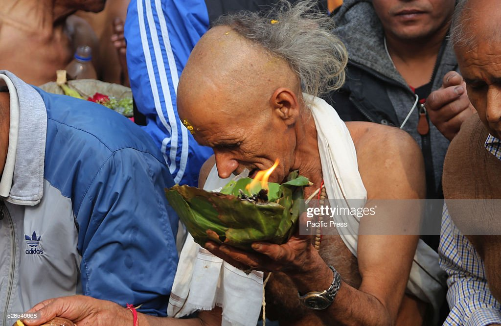 MATATIRTHA, KATHMANDU, NEPAL - : A devotee performs religious rituals on Mata Tirtha Aunsi, or the Mother's Day.