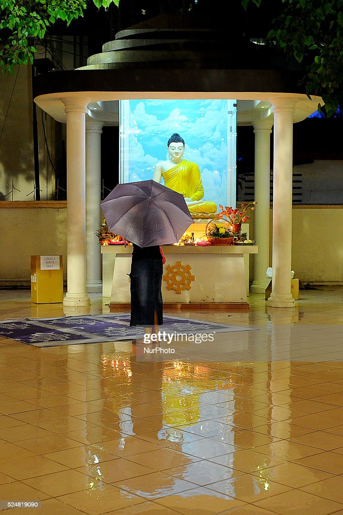 A devotee prays at a Buddha shrine during the eve of Vesak Day at temple in Kuala Lumpur Malaysia Monday May 12 2014 In Malaysia Buddha's birthday is...
