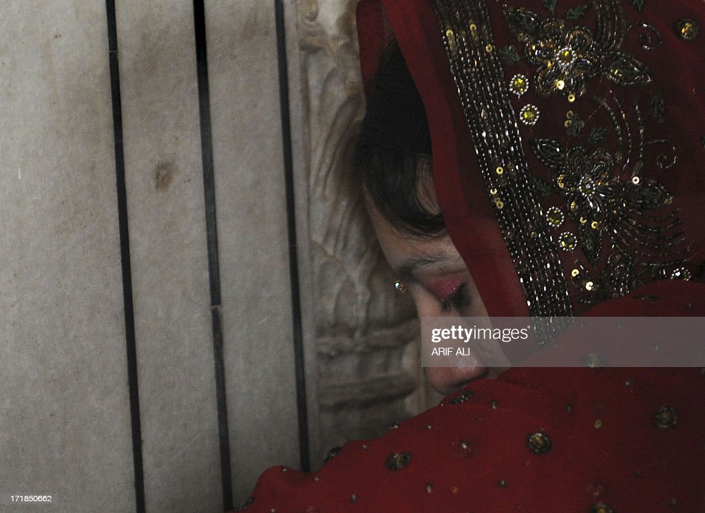 A devotee prays at a Sikh shrine in Lahore on June 29, 2013, on the 174th death anniversary of Maharaja Ranjit Singh. Singh was also known as 'Sher-e-Punjab' or 'Lion of Punjab' and is remembered for uniting the Punjab as a strong nation and his possession of the Koh-i-noor diamond. Singh, who was born in Gujranwala in 1780, was the ruler of the Pakistani Punjab province and died on June 27, 1839. AFP PHOTO/Arif ALI
