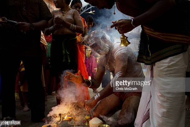 A devotee runs through his ritual before taking part in the Thaipusam procession on January 20 2011 in Singapore Singapore Thaipusam is a Hindu...