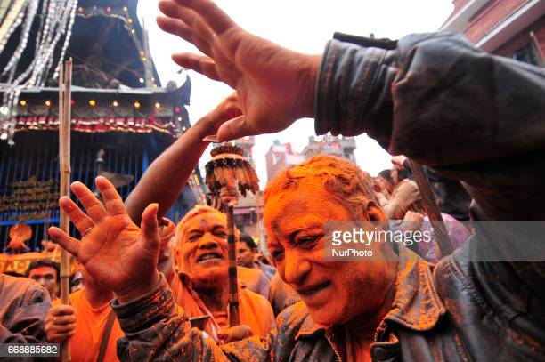 Devotee spreading vermillion powder towards his friends during the celebration of quotSindoor Jatraquot vermillion powder festival as Nepalese New...
