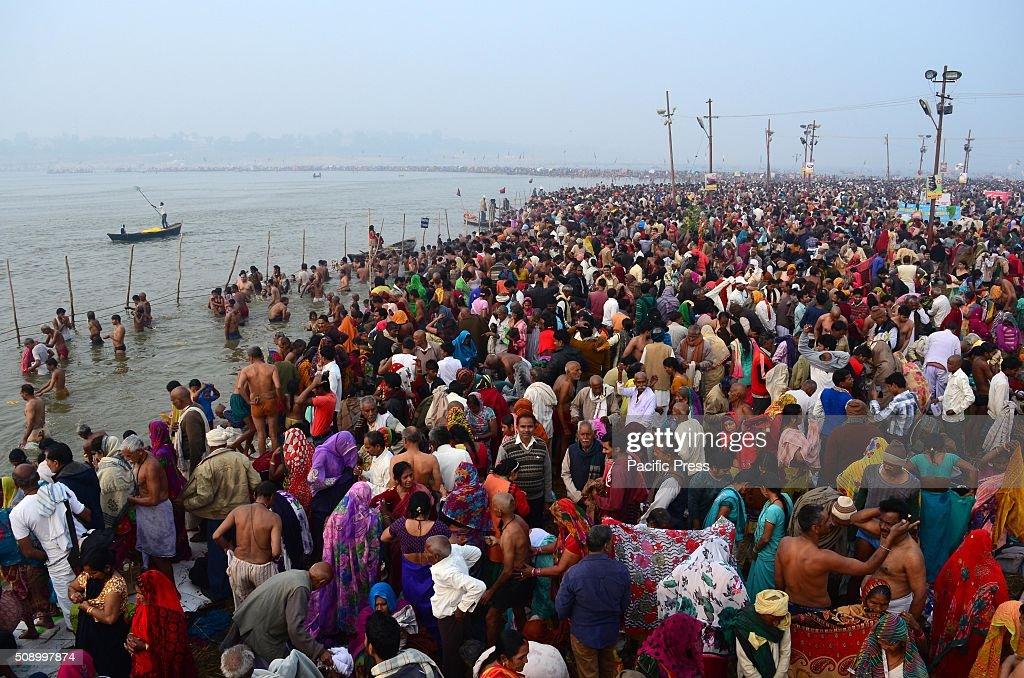 Devotee taking holydip at Sangam, the confluence of River Ganga Yamuna and mythological Saraswati on the occasion of Maghi Purnima the main holy bathing day during Magh mela festival.