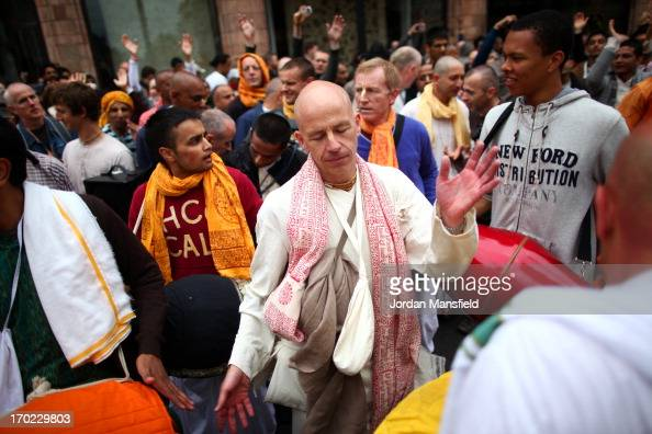 A devotee to the Hare Krishna faith dances during the Rathayatra procession through the city on June 9 2013 in London England Devotees of Lord...