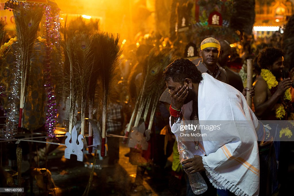 A devotee washes his face after completing his Thaipusam procession on January 27, 2013 in Batu Caves, Malaysia. Thaipusam is a Hindu festival celebrated on the full moon in the Tamil month of Thai. The festival marks the birthday of Lord Muruga and also commemorates the day Hindu Goddess Parvati gave her son a lance to defeat the evil demon Soorapadamwhen. The festival sees devotees carry milk pots to seek forgivness and some will carry a 'Kavadi' many of which are attached via, strings, hooks, and skews pierced into the carriers skin.