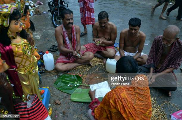Devotees are perform Tarpan a religious retiualon the bank of the river Ganges to honor the souls of their departed ancestors during the auspicious...