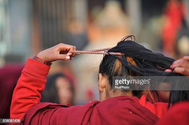 Devotees arrange hair taking sunbath after taking ritual bath in Triveni River during Madhav Narayan Festival celebrated at Panauti Village Kavre...