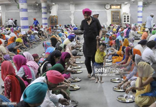 Devotees at Dukh Niwaran Sahib Grudwara on the occasion of Baisakhi festival on April 13 2017 in Ludhiana India Baisakhi is a historical and...