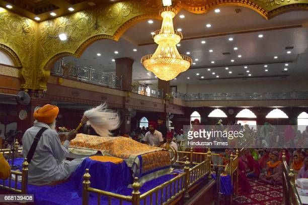 Devotees at Gurudwara Nauvi Patshahi on the occasion of Baisakhi festival on April 13 2017 in Jalandhar India Baisakhi is a historical and religious...