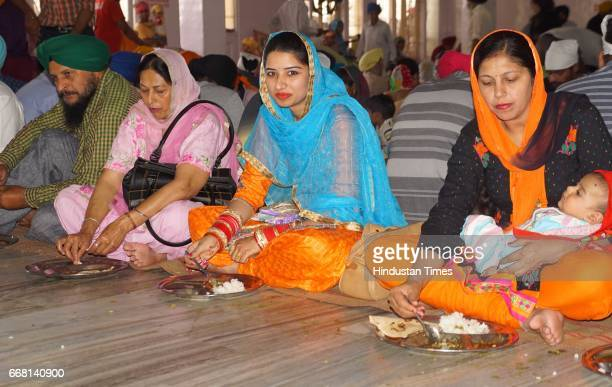 Devotees at Nadha Sahib Gurdawara on the occasion of Baisakhi festival on April 13 2017 in Panchkula India Baisakhi is a historical and religious...