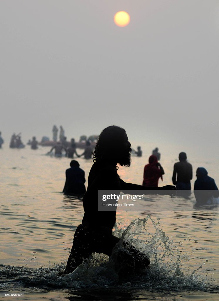 Devotees bath in holy water during Makar Sankranti at Gangasagar on January 14, 2013 near Kolkata, India. Makar Sankranti is celebrated on day when Sun enters Uttarayan (Tropic of Cancer). Hindus believe that on this day the night of gods ends and the doors of heaven open.