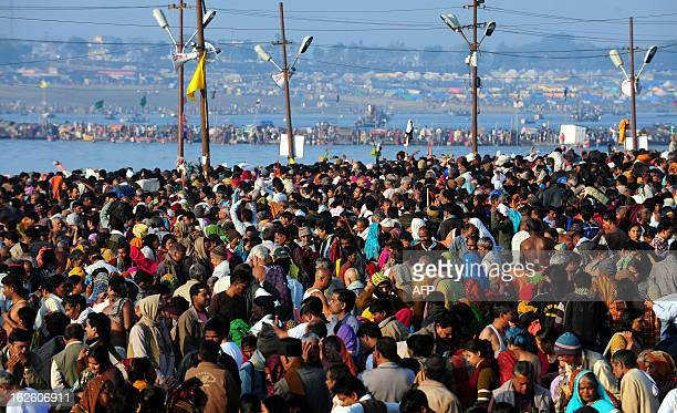 Devotees bathe on the auspicious day of 'Maghi Purnima' in the waters of Sangam the confluence of the rivers Ganges Yamuna and mythical Saraswati...