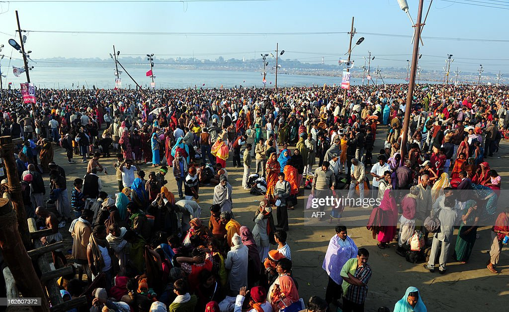 Devotees bathe on the auspicious day of 'Maghi Purnima' in the waters of Sangam, the confluence of the rivers Ganges, Yamuna and mythical Saraswati during the Maha Kumbh festival in Allahabad on February 25, 2013. The Kumbh Mela in the town of Allahabad will see up to 100 million worshippers gather over 55 days to take a ritual bath in the holy waters, believed to cleanse sins and bestow blessings. AFP PHOTO/Sanjay KANOJIA