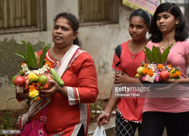 Devotees carry earthen pots on the occasion of Gokulashtami at Prabhadevi on August 15 2017 in Mumbai India The childgod Krishna and his friends used...