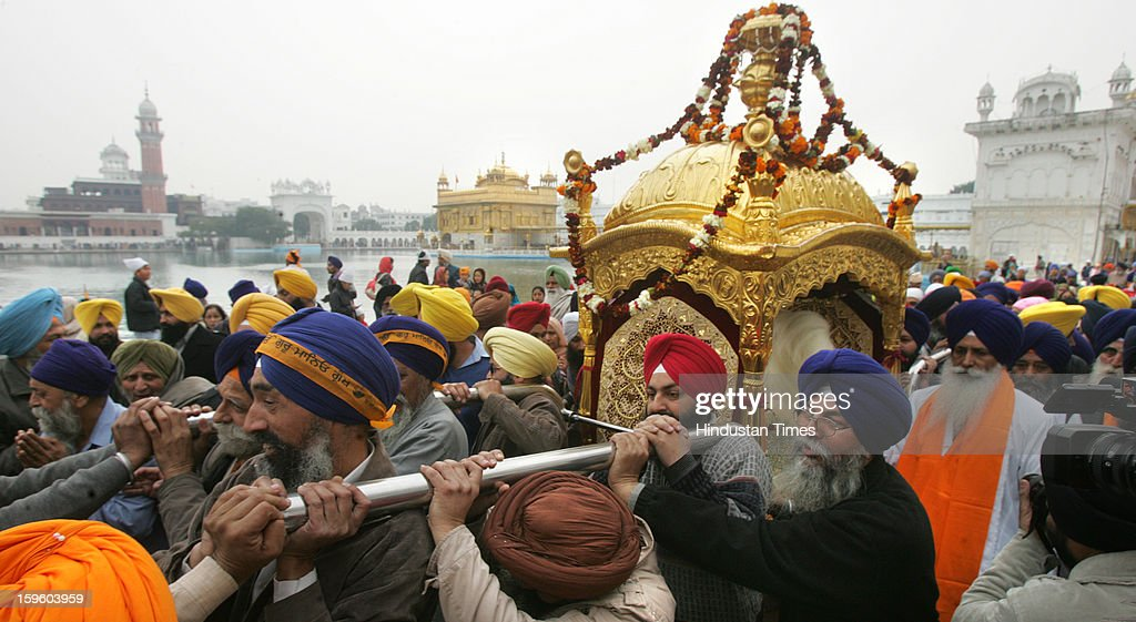 Devotees carry Palki Sahib in Harmandar Sahib complex as part of a religious procession on the eve of Birth Anniversary of 10th Sikh Guru Gobind Singh Ji, on January 17, 2013 in Amritsar, India. Guru Gobind Singh Ji was 10th and the last of the living Sikh Gurus who founded the Sikh Khalsa in 1699.