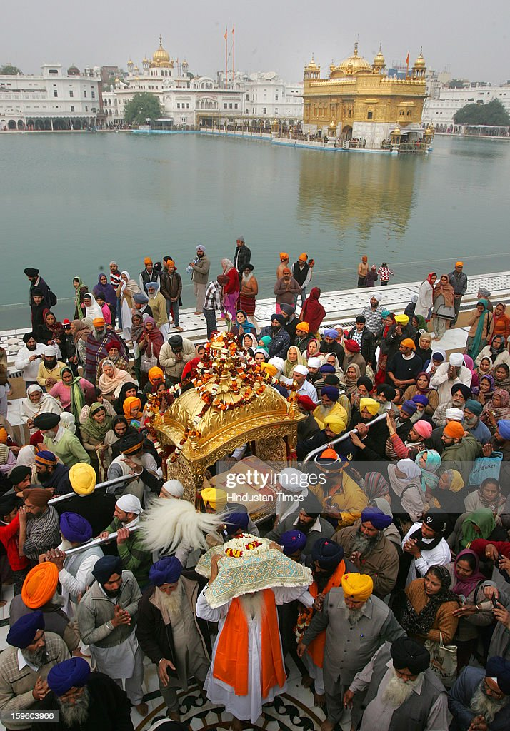 Devotees carry Palki Sahib in Harmandar Sahib complex as part of a religious procession on the eve of Birth Anniversary of 10th Sikh Guru Gobind Singh Ji, on January 17, 2013 in Amritsar, India. Guru Gobind Singh Ji was 10th and the last of the living Sikh Gurus who founded the Sikh Khalsa in 1699.