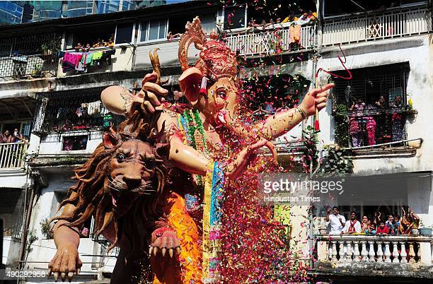 Devotees carrying an idol of Hindu Lord Ganesha to immerse in river on the last day of the Ganesh Chaturthi festival at Lalbaug on September 27 2015...