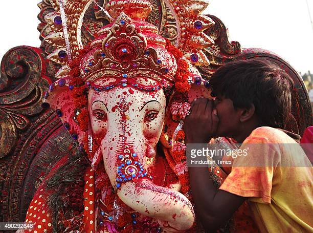 Devotees carrying an Idol of Hindu Lord Ganesha to immerse in Yamuna River on the last day of the Ganesh Chaturthi festival at Okhla on September 27...