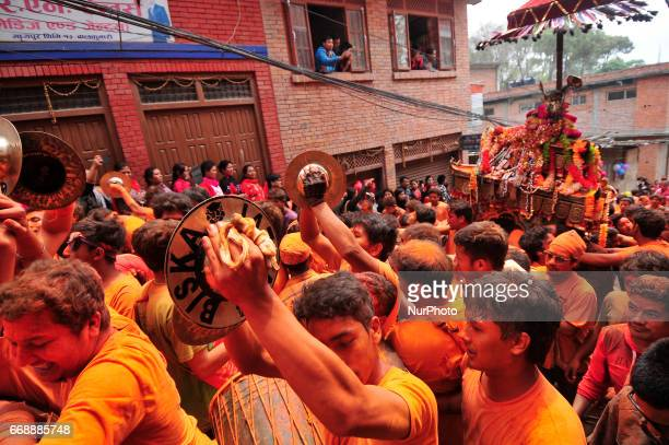 Devotees carrying chariot of deity during celebration of quotSindoor Jatraquot vermillion powder festival as Nepalese New Year day celebration at...