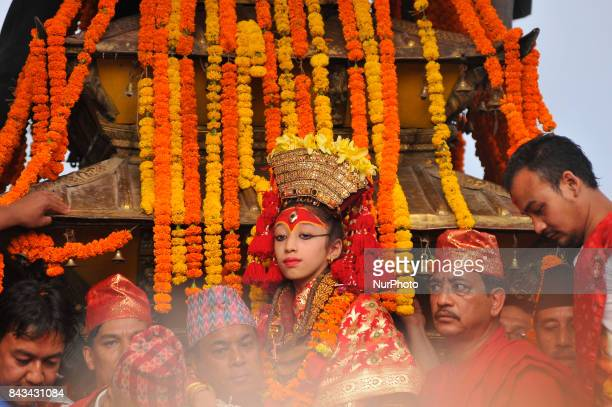Devotees carrying Goddess 'Kumari' for the chariot pulling festival on the fourth day of Indra Jatra Festival celebrated at Basantapur Durbar Square...