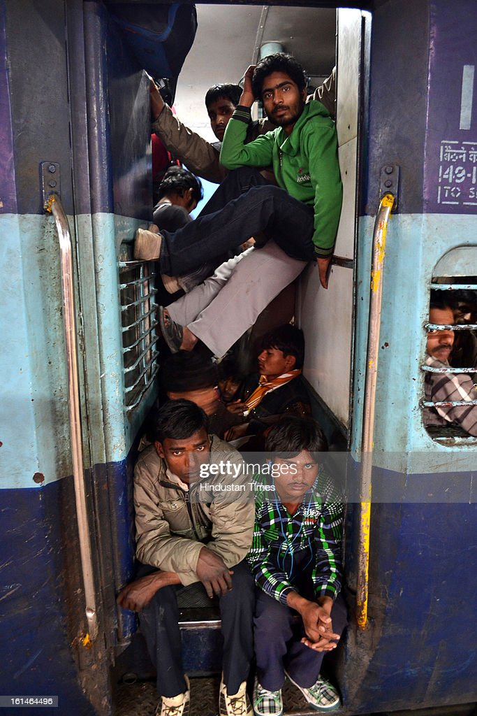 Devotees cram into a train at Allahabad train station, the site of last night's stampede, during the Maha Kumbh Mela on February 11, 2013 in Allahabad, India. According to a government sources report, at least 36 people died in a stampede on a stair case as a train was pulling up on the busiest day of the Maha Kumbh Mela.