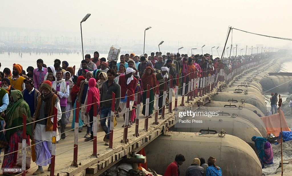 Devotees cross pontoon bridge on River Ganga to arrive at Sangam, the confluence of River Ganga Yamuna and mythological Saraswati to take holydip on the occasion of Maghi Purnima the main holy bathing day during Magh mela festival.