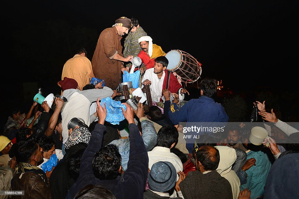 Devotees distribute communal milk at the shrine of Muslim Sufi Saint Data Ganj Bakhsh in Lahore on January 1, 2013. The three-day festival for Hazrat Ali Bin Usman, popularly known as Data Gunj Bakhsh, started with traditional zeal with a 'chaddar' laying ceremony and the distribution of communal milk at the shrine. AFP PHOTO/Arif ALI