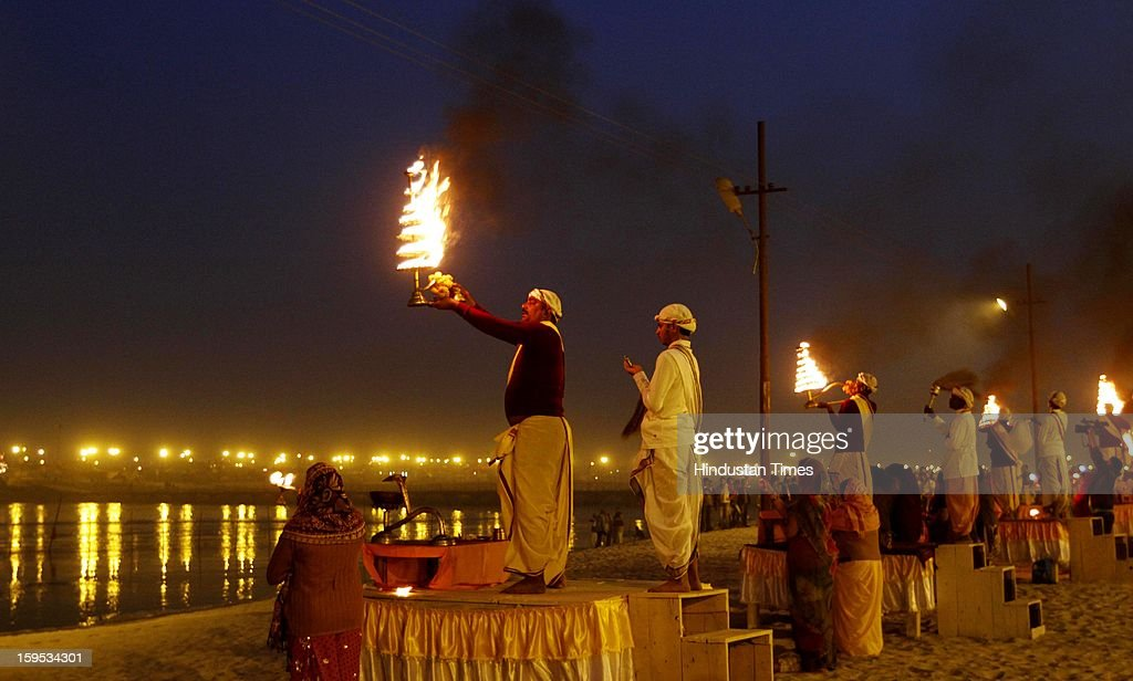 Devotees doing Ganga evening Aarti at the bank of Sangam confluence of river Ganga, Yamnuna and mythical Saraswati on the occasion of Makar Sankranti on January 15, 2013 in Allahabad, India. Kumbh is World's biggest religious gathering, in which more than 100 million of Hindus and sikh devotees will take part over next 55 days. Apart from being pilgrimage of faith, salvation and hope for millions of devotees, it also serve as meeting ground for the vast spectrum of Indian religious and spiritual views.
