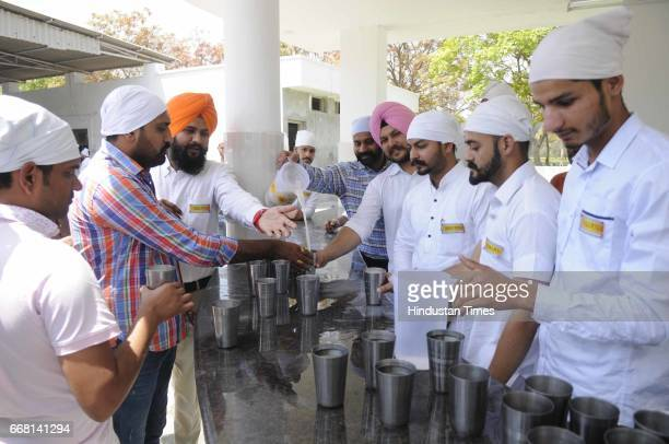 Devotees drinking sweet water at Historic Gurdwara Bhaudrgarh Sahib on the occasion of Baisakhi festival on April 13 2017 in Patiala India Baisakhi...