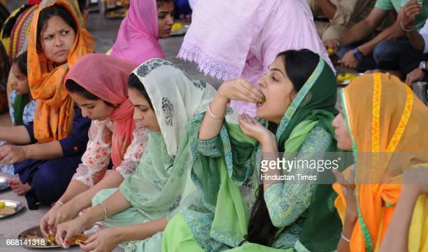 Devotees eat a langar at Punjabi University Gurdwara on the occasion of Baisakhi festival on April 13 2017 in Patiala India Baisakhi is a historical...