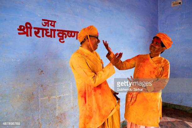 Devotees enjoy themselves singing hymns at Krishna temple in Nandgaon on Holi Barsana a village near Mathura in Uttar Pradesh observes Holi with...