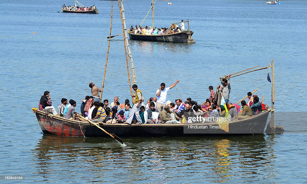 Devotees enjoying boating in Sangam on Maghi Purnima in Kumbh Mela area on February 25, 2013 in Allahabad, India. Around one Crore devotees took holy dip in Sangam on the occasion of Maghi Purnima in Allahabad.
