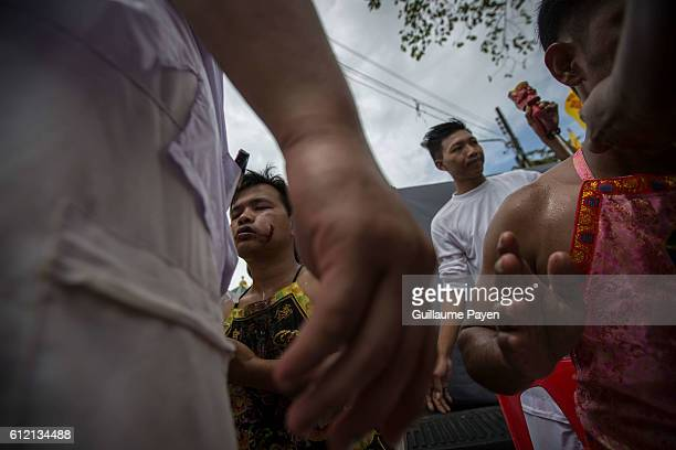 Devotees from the Chinese Kuan Tae Kun Shrine receive healthcare after being pierced with a metal ring during the yearly Vegetarian Festival also...
