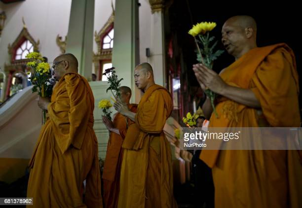 Devotees hold candles incense and lotus flowers as they perform religious rites during the early hours of Vesak Day at Chetawan Temple Kuala Lumpur...