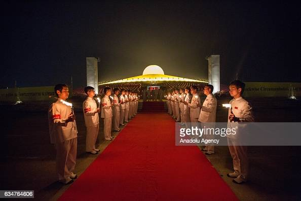 Devotees holds candles during a yearly ceremony at Wat Phra Dhammakaya Temple in the north of Bangkok Thailand on February 11 2017 Thai people...