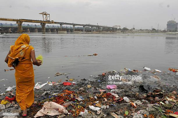Devotees immersing Goddess Durga idols in Yamuna River water of Yamuna is highly polluted flouting the order of National Green Tribunal banning such...