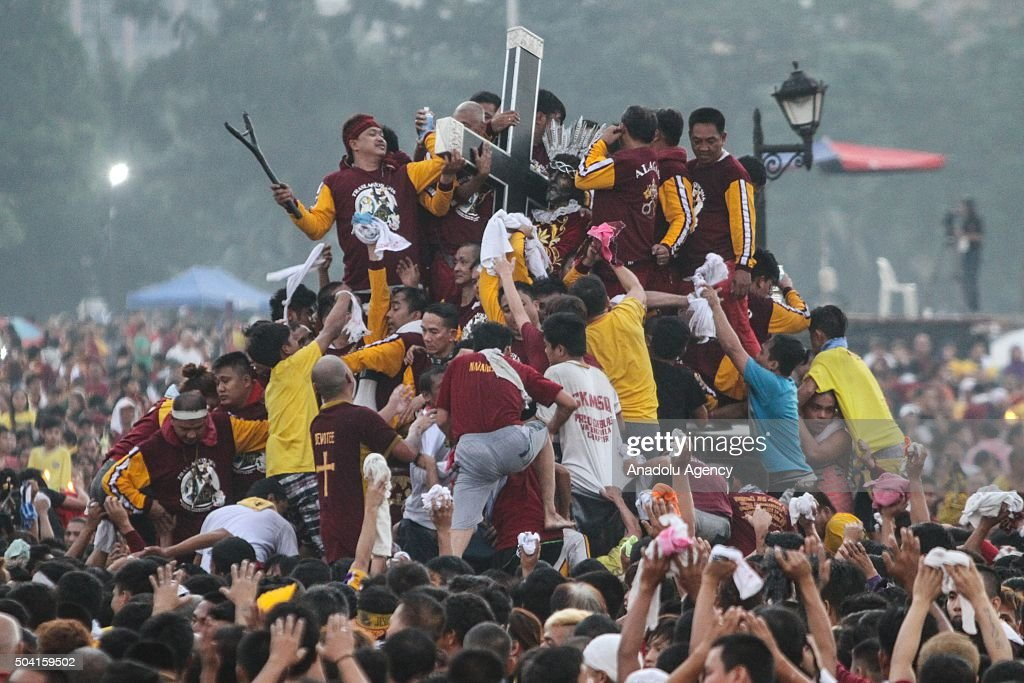 Devotees jostle to get near the carriage bearing the image of the Black Nazarene, which is believed to provide miracles, during its annual procession as it passed at National Museum building in Manila, Philippines on January 09, 2016. The raucous celebration drew tens of thousands of devotees in a barefoot procession around Manila streets.