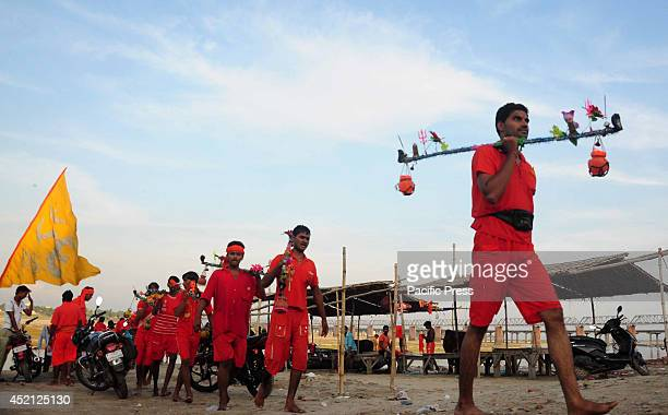 Devotees known as Kanwariya carried holy water from the River Ganges near the northern Indian city of Allahabad Kanwarias are devotees performing a...