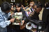Devotees leave the cemetery in La Paz on November 8 carrying with them human skulls during the celebration of the Dia de las Natitas In the Bolivian...