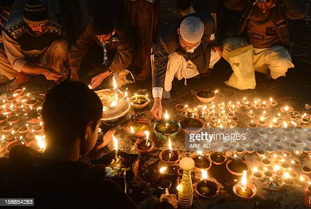 Devotees light candles at the shrine of Muslim Sufi Saint Data Ganj Bakhsh in Lahore on January 1 2013 The threeday festival for Hazrat Ali Bin Usman...
