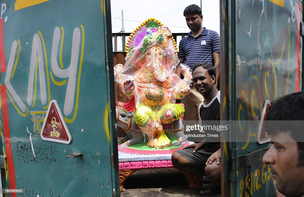 Devotees loading the idol of Lord Ganesha on eve of Hindu festival Ganesha Chaturthi on September 8, 2013 in New Delhi, India. Ganesh Chaturthi, which begins from September 9, is celebrated as the birthday of Lord Ganesha who is widely worshiped by Hindus as the god of wisdom, prosperity and good fortune.