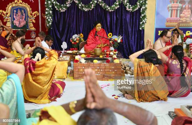 Devotees of Her Holiness Amma Sri Karunamayi performs special prayers during the Homa at the Bhuvaneswari Amman Temple in Brampton Ontario Canada on...