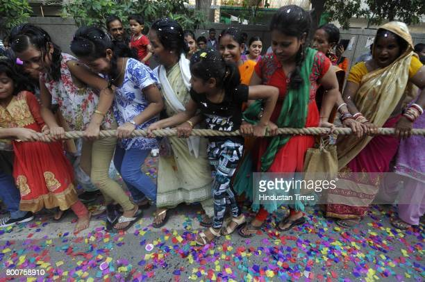 Devotees of Lord Krishna take out a procession of Lord Jagannath Ratha Yatra chanting Hare Krishna Maha Mantra on June 25 2017 in Noida India Ratha...