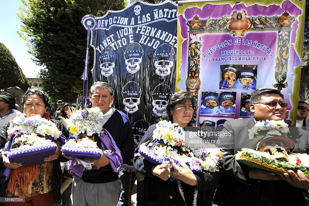 Devotees of the 'ñatitas' leave the church on November 8 2011 at the general cemetery in La Paz According to a traditional preColumbian Andean ritual...