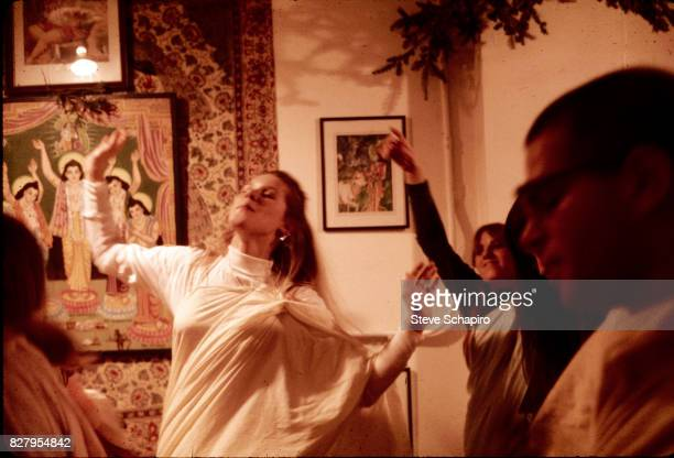 Devotees of the International Society for Krishna Consciousness better known as Hare Krishnas dance and worship at their storefront temple New York...